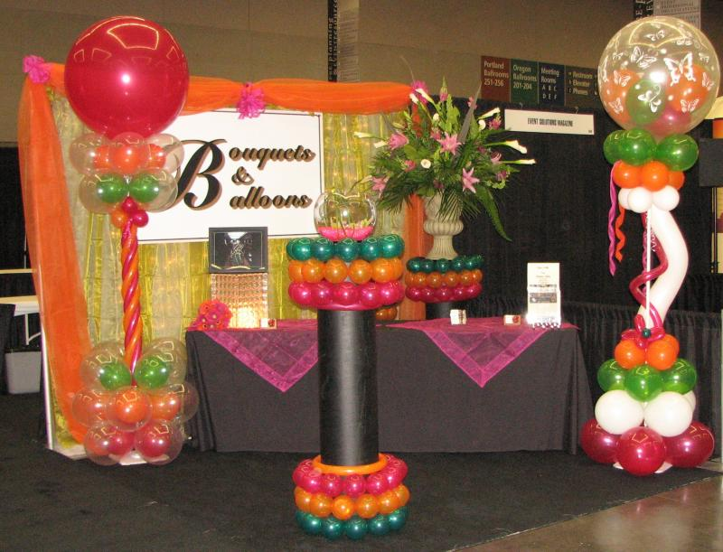 Bouquets & Balloons tradeshow booth with flowers and balloons